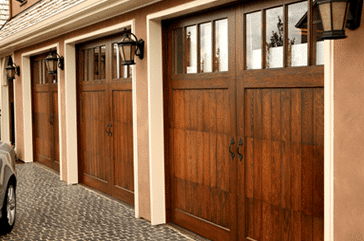Three wood Residential carriage style garage doors